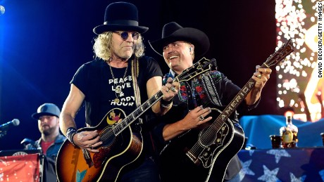 "Big Kenny and John Rich of Big & Rich led an emotional singalong of ""God Bless America."""