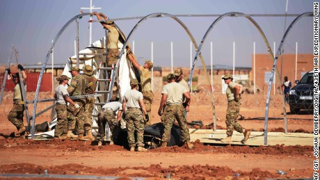 US airmen frtake down tents from the old base to move to a new location, on September 11, 2017, at Air Base 201 in Agadez, Niger.