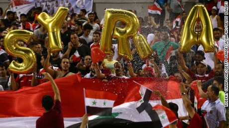 Syria fans cheer on their team ahead of the World Cup qualifier against Australia.