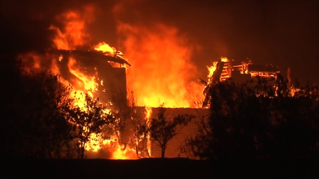 Fast-moving wildfires kill 10, devour buildings in Northern California
