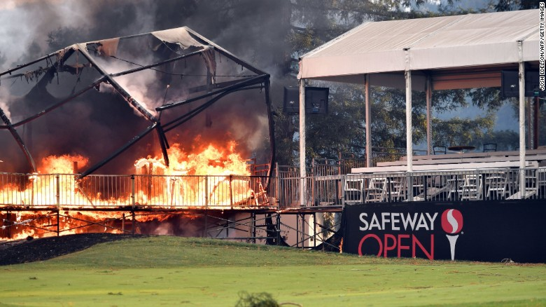 A tent structure built for the 2017 Safeway Open burns Monday on a golf course at the Silverado Resort and Spa in Napa.