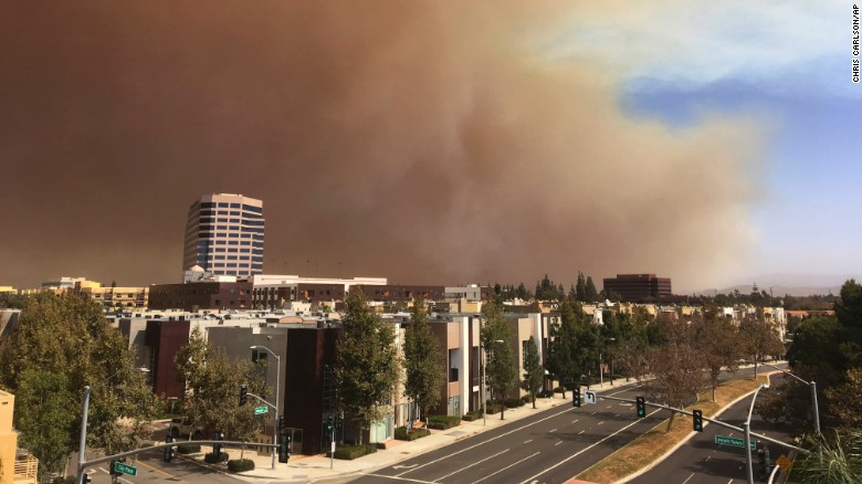 A large plume of smoke rises over the city of Orange, California, on Monday. The wildfire started Monday about 45 miles southeast of Los Angeles in the hill country of eastern Orange County, the Anaheim Fire Department said.