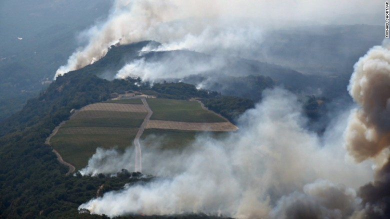 Smoke rises as a wildfire burns in the hills north east of Napa on Monday.