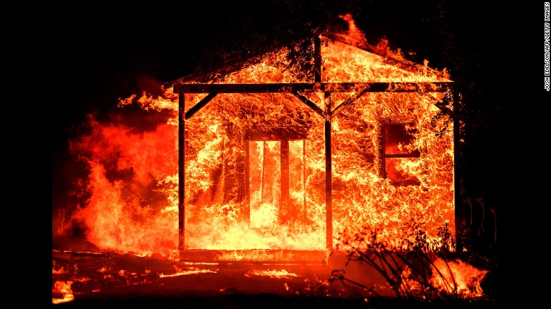 Flames overtake a structure in the Napa wine region on October 9.