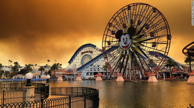 Fires are evident Monday in this Junior Olivas photo at Disneyland California Adventure Park in Anaheim.