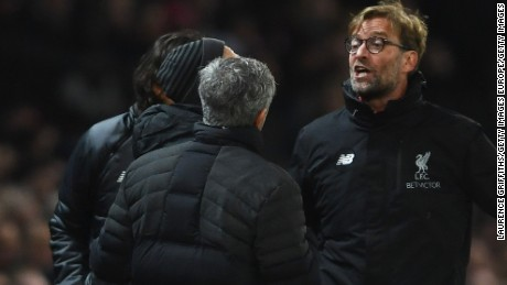 Mourinho and Klopp argue on the touchline during a Premier League match between their sides in January