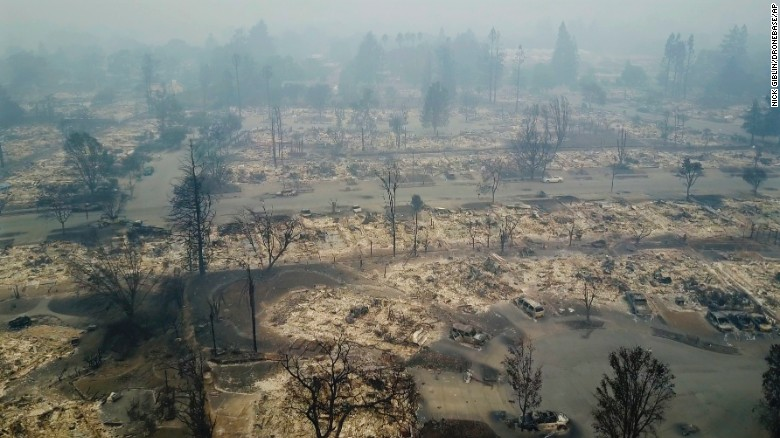 "An aerial photo shows a Santa Rosa neighborhood destroyed by a wildfire on Tuesday, October 10. <a href=""http://www.cnn.com/2017/10/10/us/california-fires-napa/index.html"">More than a dozen wildfires</a> are raging across Northern California, with the biggest ones scorching the state's famous wine areas."