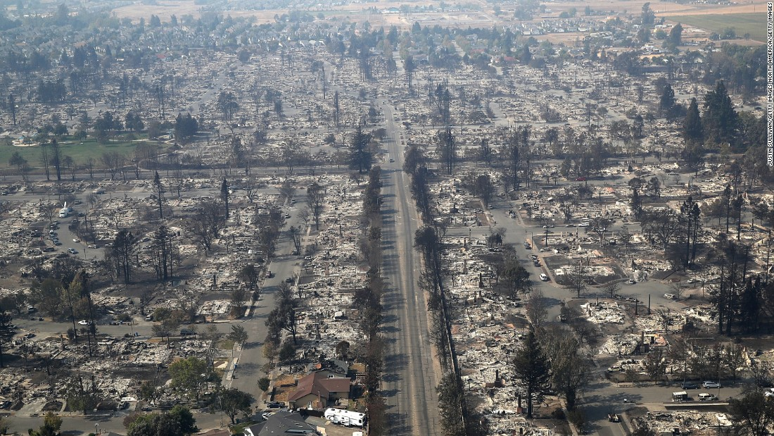 Homes are destroyed in the Coffey Park neighborhood of Santa Rosa, California, on Wednesday, October 11. Deadly wildfires have been tearing through the state, destroying homes and businesses and prompting evacuation orders.