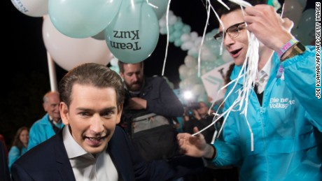 Sebastian Kurzs is greeted by supporters before a television debate.