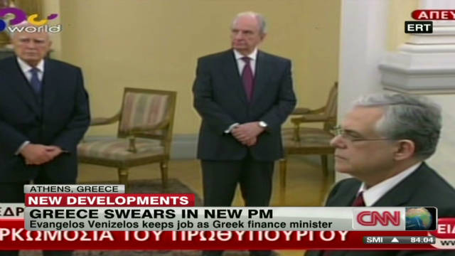 Greece swears in Papademos at head of unity government ...