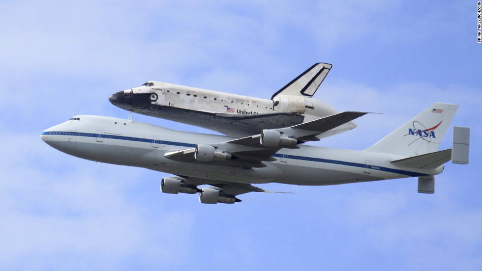 NASA's last space shuttle on nostalgic flight to ...