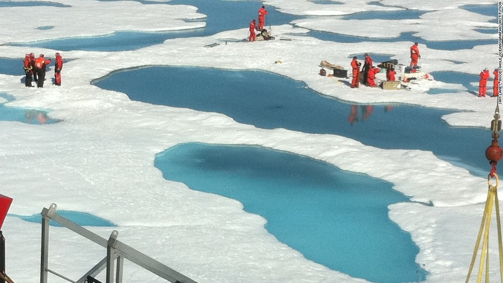 Optical properties of deep glacial ice at the South Pole