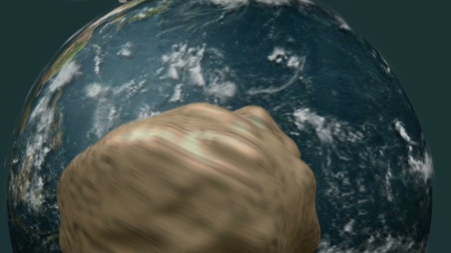Large asteroid safely zips past Earth, dragging its moon ...