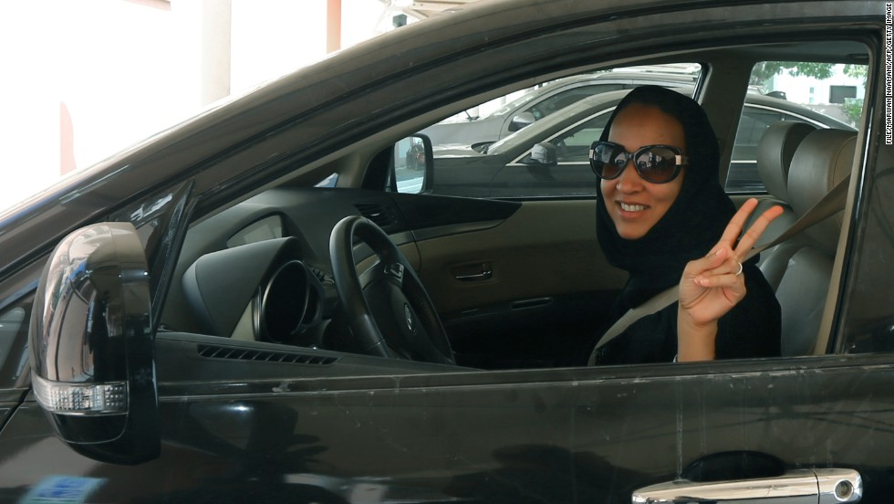 Saudi activist, Manal Al Sharif, drives her car in Dubai in October 2013 in defiance of the authorities to campaign for women's rights to drive in Saudi Arabia.