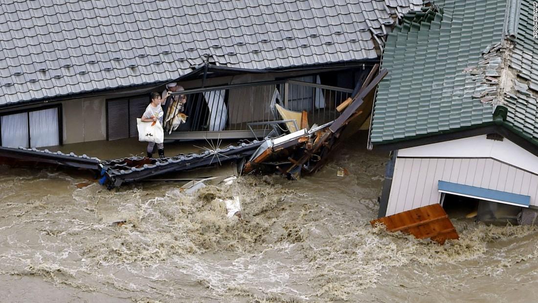 Japan flooding: 3 deaths, levee breaks, many missing - CNN