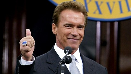 California Governor Arnold Schwarzenegger gives a thumbs up after delivering his inaugural speech at the State Capitol in Sacramento, CA 17 November 2003. Photo credit should read HECTOR MATA/AFP/Getty Images