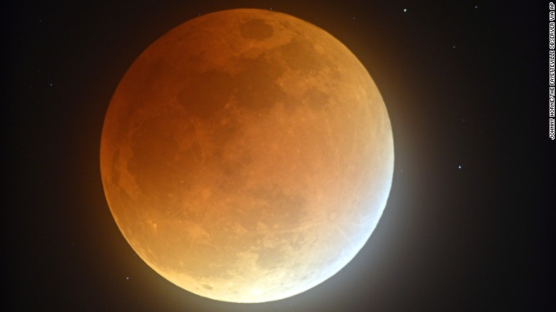 Earth's shadow partially obscures the view of a perigree full moon, or supermoon, during a lunar eclipse as seen from Stedman, North Carolina, on Sunday, September 27. The combination of a supermoon and total lunar eclipse last occurred in 1982 and will not happen again until 2033.