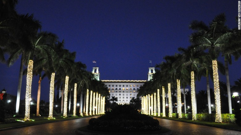 The Breakers in Palm Beach, Florida, welcomes guests along an alley of twinkling palms.