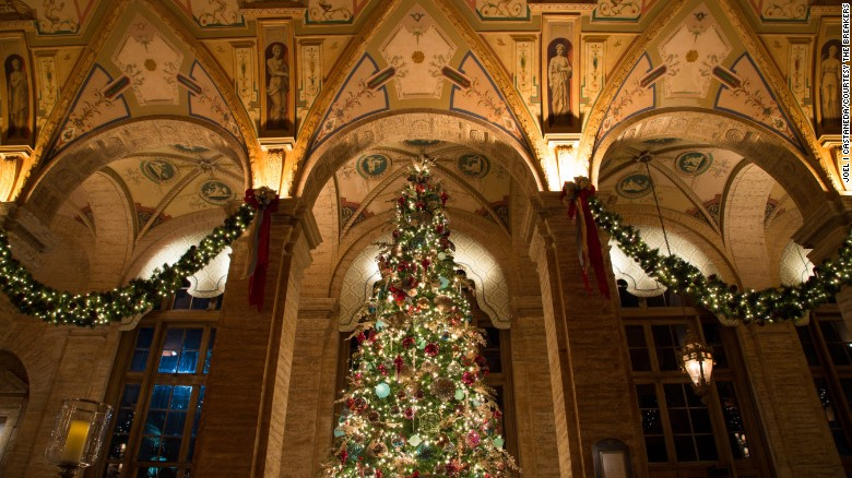 Inside, holiday decorations heighten the drama in the Renaissance-inspired lobby.