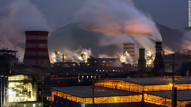 Smoke billows from smokestacks and a coal-fired generator at a steel factory in China's Hebei province.