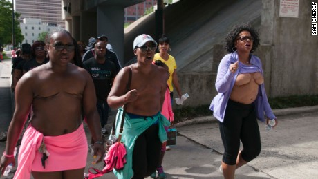 """In some cities along the way, Paulette Leaphart was joined by others for community walks. This group in Charlotte sang hymns and chanted """"We need a cure"""" and """"Breast cancer sucks."""""""