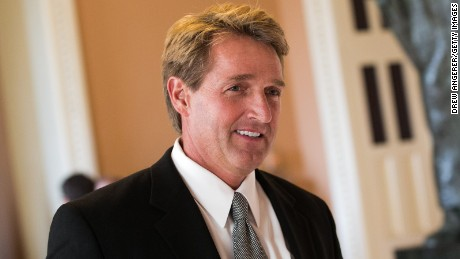 Sen. Jeff Flake walks to a Senate joint caucus meeting, on Capitol Hill.