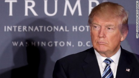 Republican presidential nominee Donald Trump attends the grand opening ceremony at the new Trump International Hotel October 26, 2016 in Washington, DC. The hotel, built inside the historic Old Post Office, has 263 luxry rooms, including the 6,300-square-foot 'Trump Townhouse' at $100,000 a night, with a five-night minimum. The Trump Organization was granted a 60-year lease to the historic building by the federal government before the billionaire New York real estate mogul announced his intent to run for president.