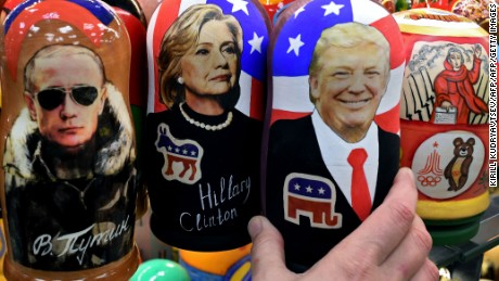 Traditional Russian wooden nesting dolls, Matryoshka dolls, depicting Russia's President Vladimir Putin, US Democratic presidential nominee Hillary Clinton and US Republican presidential nominee Donald Trump are seen on sale at a gift shop in central Moscow on November 8, 2016. A nervous world turned its gaze to America's 200 million-strong electorate November 8, 2016 as it chooses whether to send the first female president or a populist property tycoon to the White House. / AFP / Kirill KUDRYAVTSEV        (Photo credit should read KIRILL KUDRYAVTSEV/AFP/Getty Images)