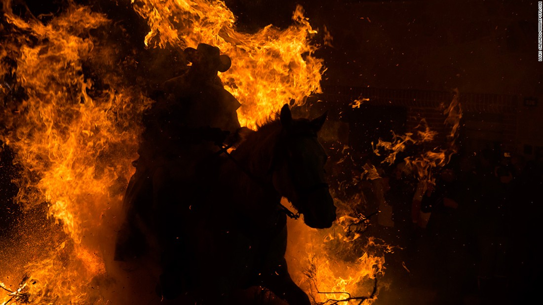 Lluís Salvadó of Spain scooped top prize in the Journeys & Adventures single image category for this shot from the fiery festival of Saint Anton in San Bartolomé de Pinares, Spain.