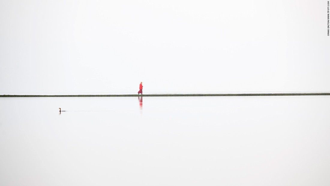 The Wirral Peninsula in the northwest of England is the scene of this unusual image taken by Craig Easton. It shows a lone Buddhist monk walking around the boundary wall of a lake. Easton's series of images from the Wirral earned him the top prize in the Land, Sea, Sky portfolio category.