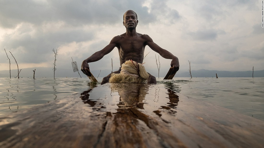 This image by overall winner Joel Santos shows a man of the Ashanti people using traditional fishing techniques in Lake Bosumtwi in Ghana.