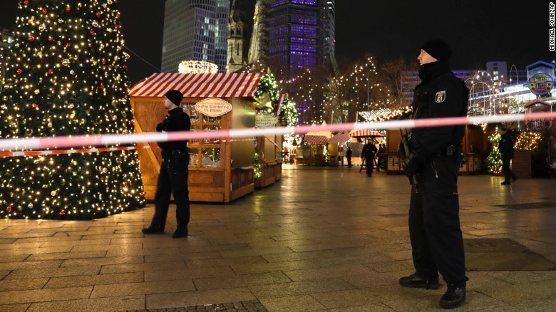 Police guard a Christmas market after a truck ran into the crowded sidewalk in Berlin on Monday evening.