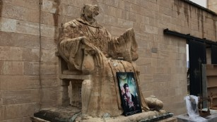 A religious statue vandalized by ISIS stands outside Mart Shmoni Church in Bartella, Iraq.