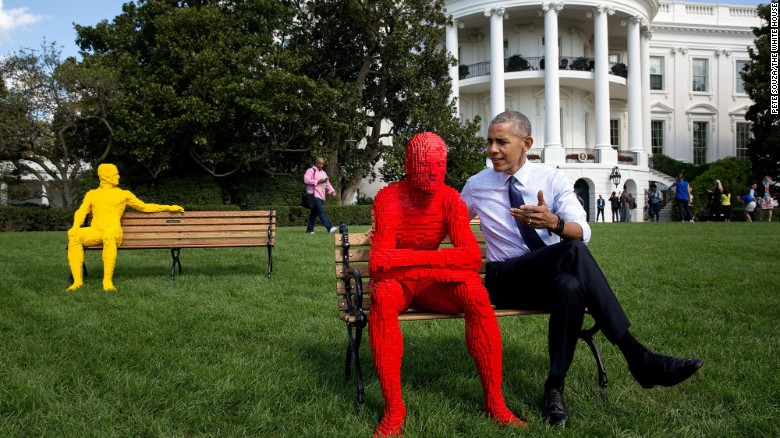 """""""The White House was hosting South by South Lawn, an event based on the infamous South by Southwest event in Austin, Texas. Just before lunch that day, the President was checking out the setup from a window in the Oval Office before the gates were opened. 'Hey Pete,' he said to me, 'let's go take a picture with the LEGO® men.' And so we did."""" (Official White House Photo by Pete Souza)"""