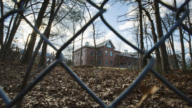 A fence encloses an estate in the village of Upper Brookville in the town of Oyster Bay, N.Y., on Long Island on Friday, Dec. 30, 2016. On Friday, the Obama administration closed this compound for Russian diplomats, in retaliation for spying and cyber-meddling in the U.S. presidential election. (AP Photo/Alexander F. Yuan)