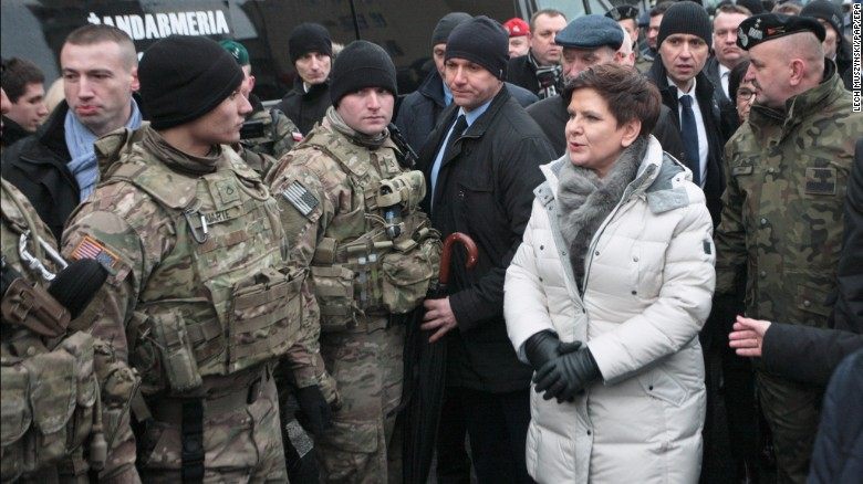 Polish Prime Minister Beata Szydlo speaks with members of the US army during an official welcome event for US troops in Zagan, Poland, on January 14.