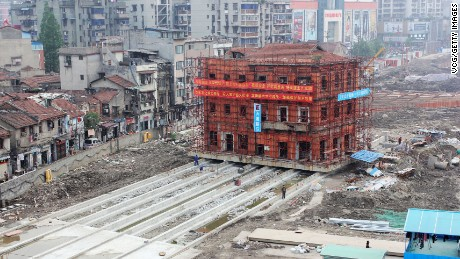 WUHAN, CHINA - APRIL 27:  (CHINA OUT) Workers make the monolithic Hankou Yiyong fire association building move east on April 27, 2016 in Wuhan, Hubei Province of China. The 3-story fire association building which, was built in the early Republic of China, had been moved 4.5 meters on the first day and would be moved 70 more meters east in 10 days.  (Photo by VCG/VCG via Getty Images)