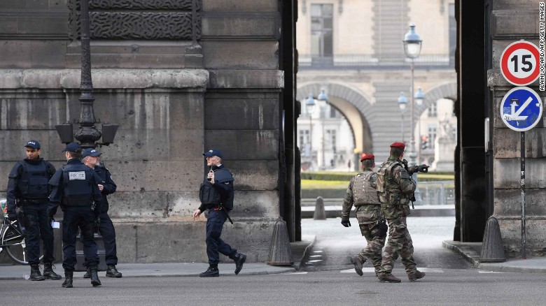 French police officers and soldiers patrol in front of the Louvre museum on Friday after a security incident.