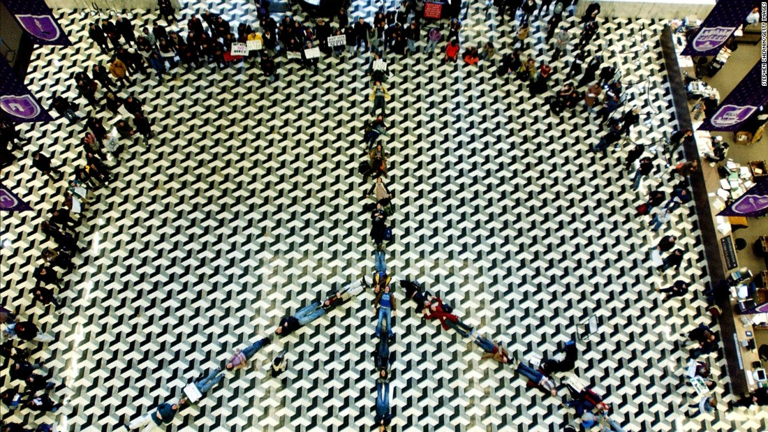 <strong>New York University</strong> students lay down to form a peace symbol on the floor of the NYU library in 2003 to protest the impending war in Iraq.