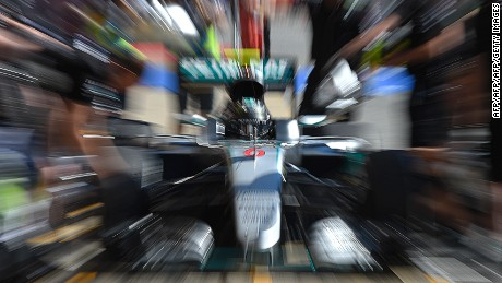 TOPSHOT - Mercedes AMG Petronas F1 Team's German driver Nico Rosberg arrives  in the pits during the first practice session at the Circuit de Catalunya on May 13, 2016 in Montmelo on the outskirts of Barcelona ahead of the Spanish Formula One Grand Prix / AFP / LLUIS GENE        (Photo credit should read LLUIS GENE/AFP/Getty Images)