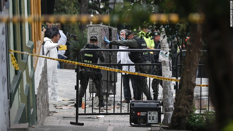 Colombian police investigate an explosion near a bullring in Bogota on Sunday.