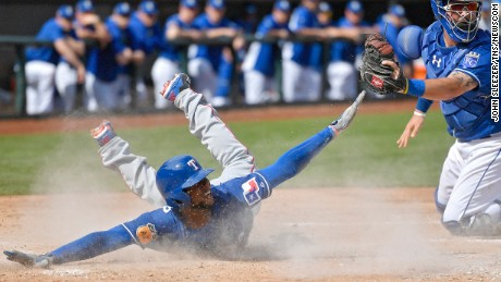 Texas Rangers' Jurickson Profar scores past Kansas City Royals catcher Cam Gallagher on a grounder by Delino DeShields in the second inning during a spring training baseball game on Sunday, Feb. 26, 2017 in Surprise, Ariz. (John Sleezer/Kansas City Star/TNS) (Newscom TagID: krtphotoslive780512.jpg) [Photo via Newscom]
