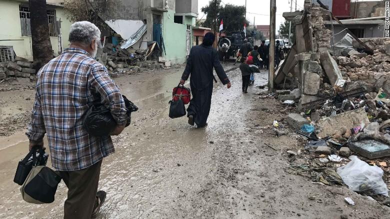People fleeing west Mosul.