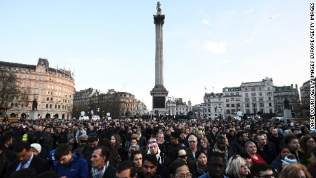 People gather ahead of a candlelit vigil at Trafalgar Square on March 23, 2017 in London, England.