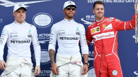 Lewis Hamilton claimed pole for Mercedes ahead of Ferrari's Sebastian Vettel (right) with teammate Valtteri Bottas third fastest.