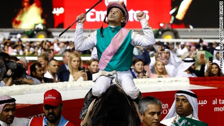 Jockey Mike Smith celebrates winning the Dubai World Cup at the Meydan Racecourse with Arrogate.