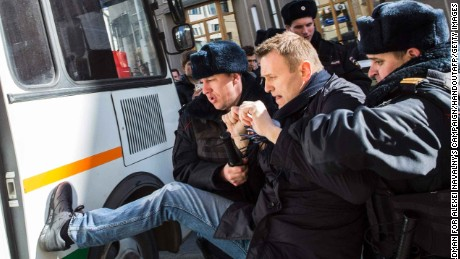 "TOPSHOT - This handout picture taken and provided by Evgeny Feldman for Alexei Navalny's campaign on March 26, 2017 shows police officers detaining Kremlin critic Alexei Navalny during an unauthorised anti-corruption rally in central Moscow. / AFP PHOTO / Evgeny Feldman for Alexei Navalny's campaign / HO / RESTRICTED TO EDITORIAL USE - MANDATORY CREDIT ""AFP PHOTO / Evgeny Feldman for Alexei Navalny's campaign"" - NO MARKETING NO ADVERTISING CAMPAIGNS - DISTRIBUTED AS A SERVICE TO CLIENTS  HO/AFP/Getty Images"