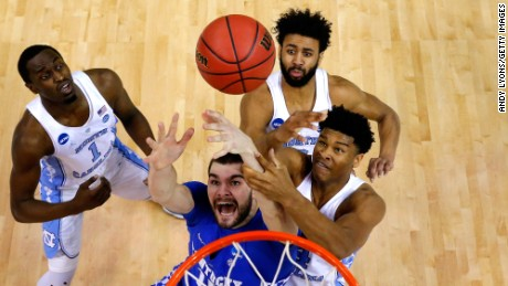 MEMPHIS, TN - MARCH 26: Isaac Humphries #15 of the Kentucky Wildcats competes for a rebound with Theo Pinson #1, Isaiah Hicks #4 and Joel Berry II #2 of the North Carolina Tar Heels in the first half during the 2017 NCAA Men's Basketball Tournament South Regional at FedExForum on March 26, 2017 in Memphis, Tennessee.  (Photo by Andy Lyons/Getty Images)