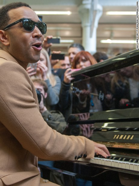 John Legend surprises visitors at St Pancras train station in London on Wednesday