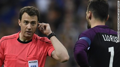 TOPSHOT - Referee Felix Swayer asks video assitance next to Hugo Lloris France's goalkeeper during the friendly football match France vs Spain on March 28, 2017 at the Stade de France stadium in Saint-Denis, north of Paris. / AFP PHOTO / CHRISTOPHE SIMON        (Photo credit should read CHRISTOPHE SIMON/AFP/Getty Images)